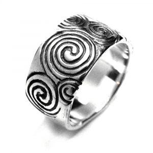 Anneau alliance gravures spirales menhir newgrange