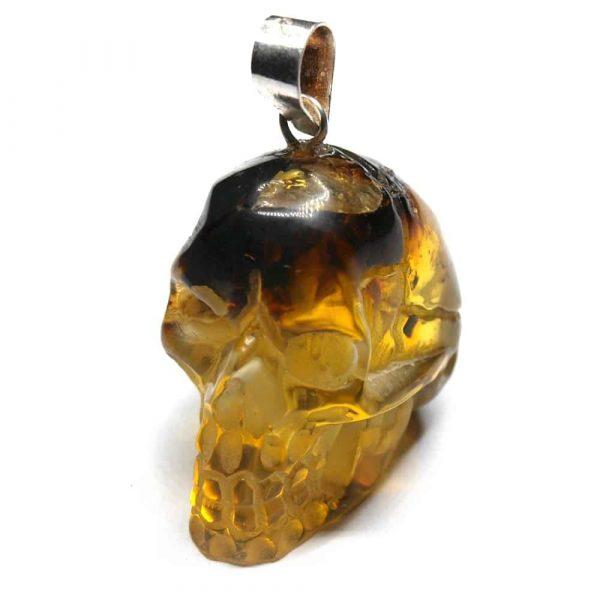 Pendentif ambre tête de mort 22x20x16mm 4.12gr jaune AMB_PDT_001_001
